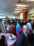 The huge crowd in the lobby during the reception hour, making bids on silent auction items