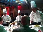 Jason Knapp presenting a dish to the judges