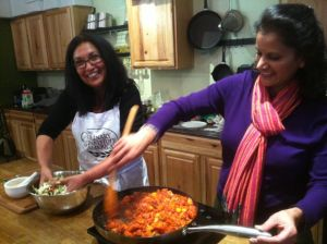 Meenakshi Budhraja and Usha Mittal prepare the Indian vegetarian meal for the hungry onlookers.