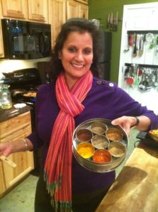 Usha Mittal displays her personal stash of amazing Indian spices she used in her dishes at Eggshells.