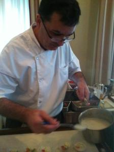 New Capital Hotel Executive Chef prepares Coconut Soup with Crab Dumplings at last night's Governor's Culinary Challenge.
