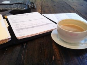 My paperwork and my enormous, shockingly inexpensive, delicious latte.
