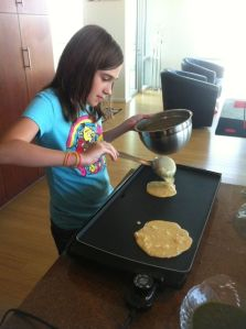 Big Kid pouring the chilla, or savory pancakes