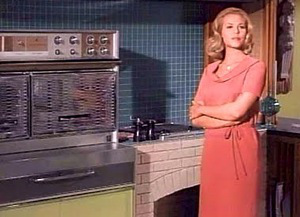 "Samantha Stephens on the set of ""Bewitched,"" next to the jet-age Fridigaire Flair used on the set."