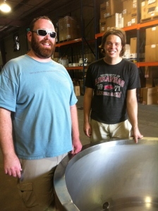 Local cheesemakers (x) and Kent Walker are quite giddy over their new cheesemaking tub.