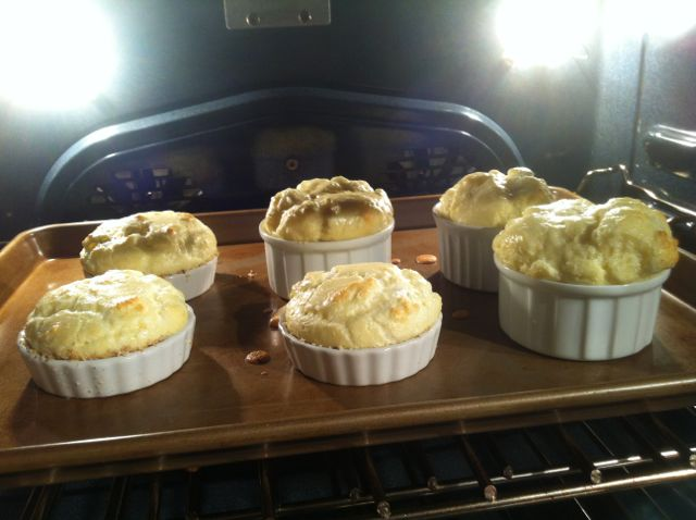 The soufflés begin their rise to stardom in the oven.