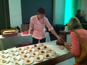 Kelli Marks of Sweet Love describes each dish to a Signature Chef Gala patron.