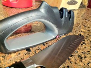 Wüsthof two-stage knife sharpener I just bought at Kreb's, and the crappy santoku it resurrected.