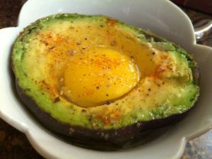 Seasoned egg and avocado, ready for the microwave.