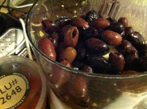 Kalamata olives about to get the grind.