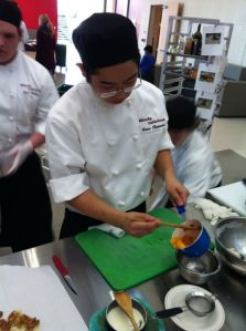 A student from North Pulaski High School's Simply Delicious restaurant competing last week. North Pulaski's team won the culinary competition.