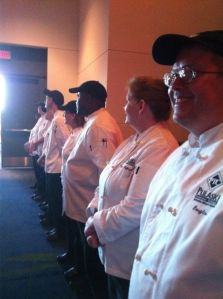 Students and faculty line both sides of the doors while welcoming Diamond Chef guests.